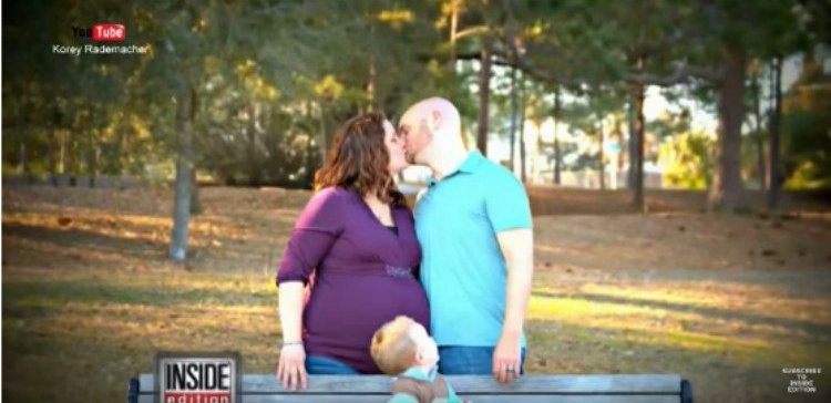 Rademacher couple kisses in maternity photo