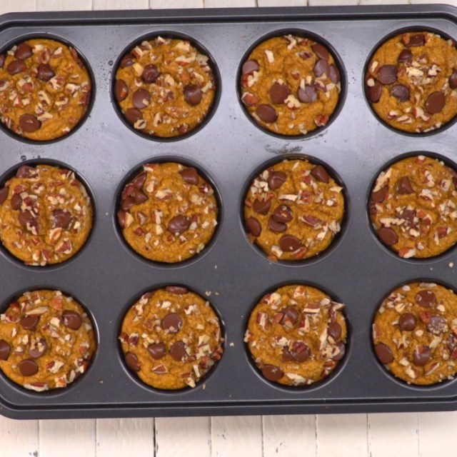 Muffin tin of baked flourless healthy pumpkin muffins