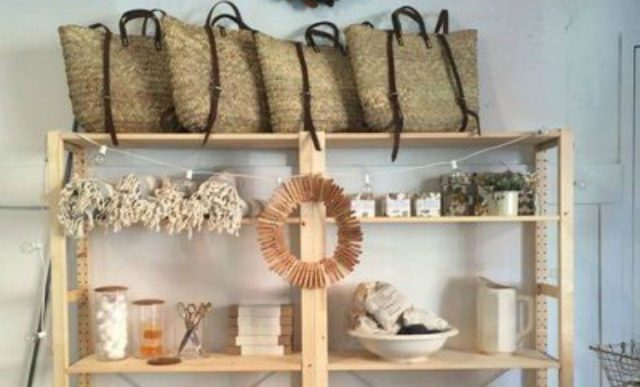 clothespin wreath hanging from shelf
