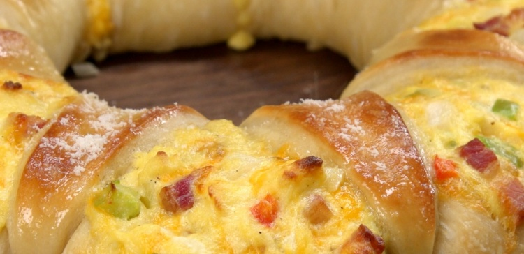 Close-up of baked pizza crown filled with eggs and bacon
