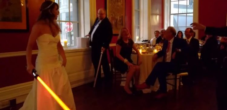 Wedding dance turns into lightsaber battle.