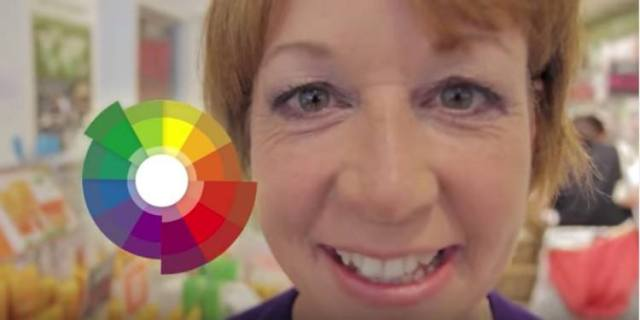 woman posing next to color wheel