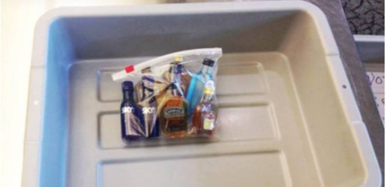 mini alcohol bottles in a plastic bag on tray