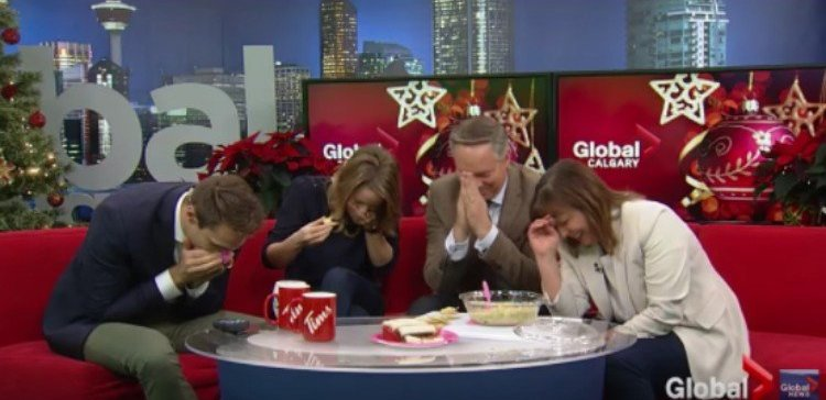 news anchors laughing over spinach dip