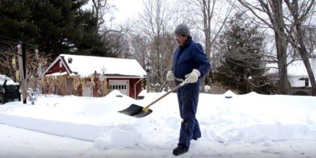 man shoveling with rope shovel