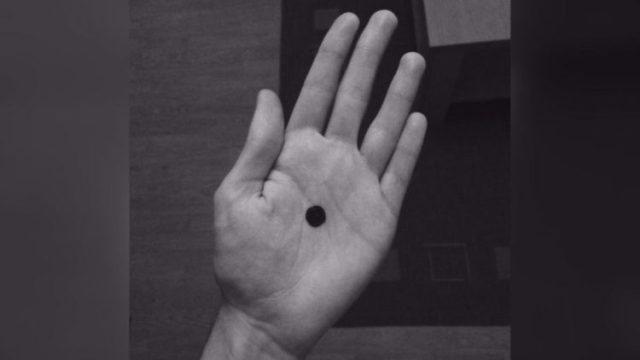 Black dot in a black and white picture.