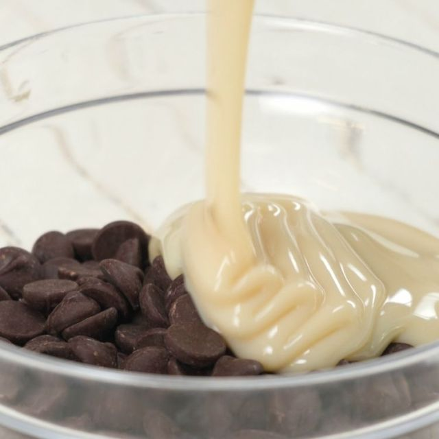 Place the dark chocolate chips and the sweetened condensed milk in a large, microwave-safe bowl