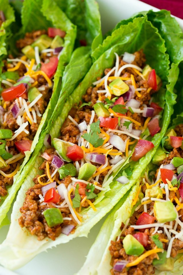 Healthy lettuce wraps stuffed with turkey.