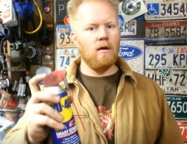 Image of man with aerosol can.