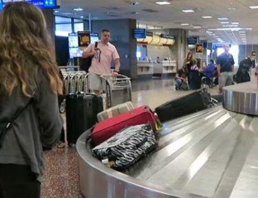 Image of airport baggage claim.