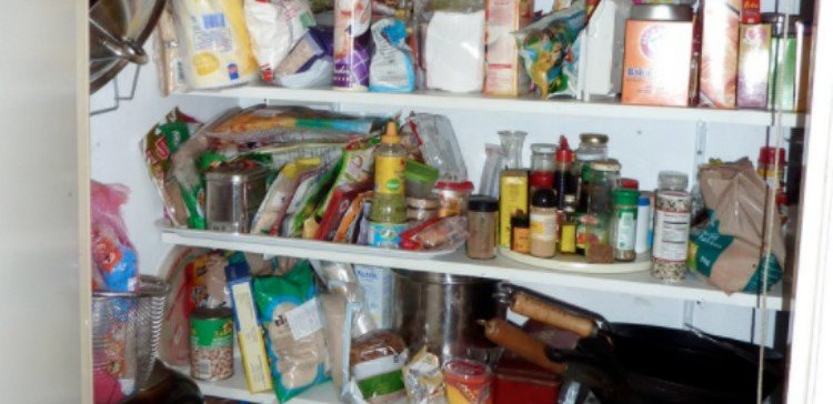 cluttered pantry with various food and cooking items