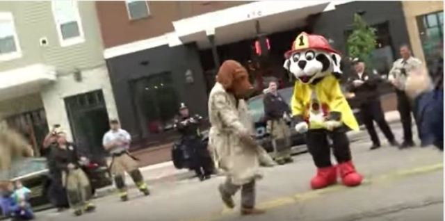 McGruff and Sparky dancing with first responders