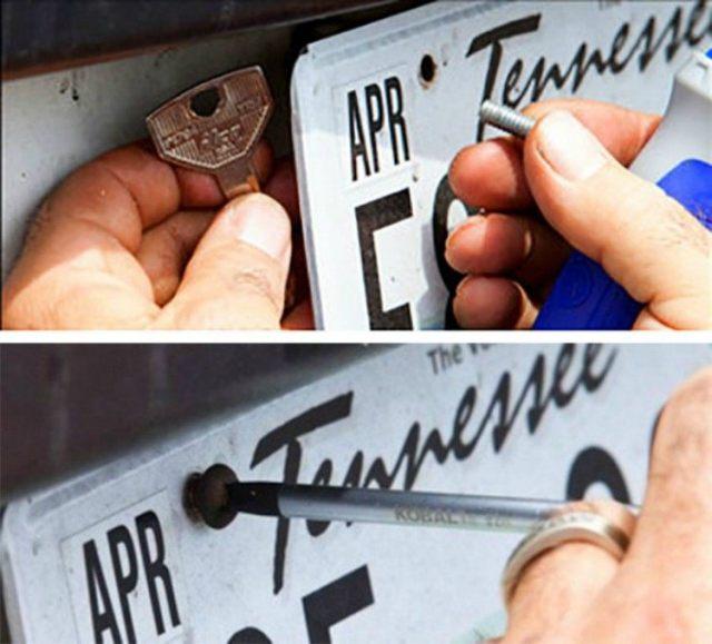 Screwing key behind license plate.