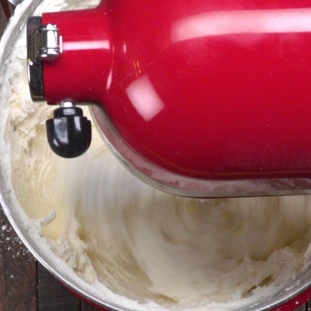 Mix buttercream frosting until light and fluffy