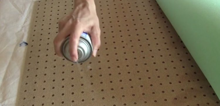 Spray a light coat of adhesive to the front of the pegboard