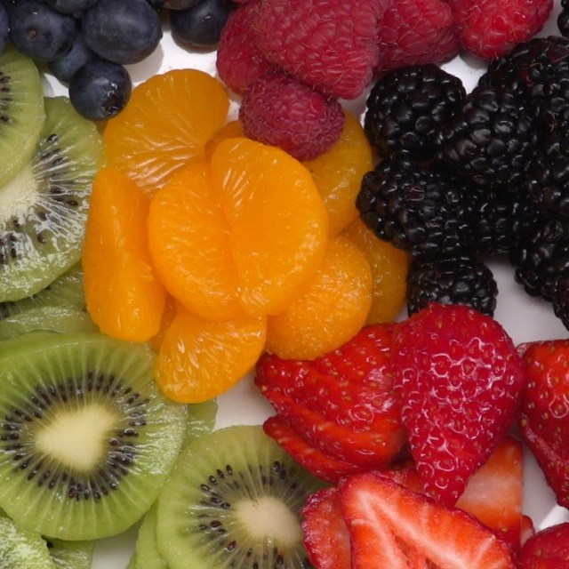 sugar cookie fruit tart cut kiwi strawberry mandarin orange blackberry raspberry blueberry