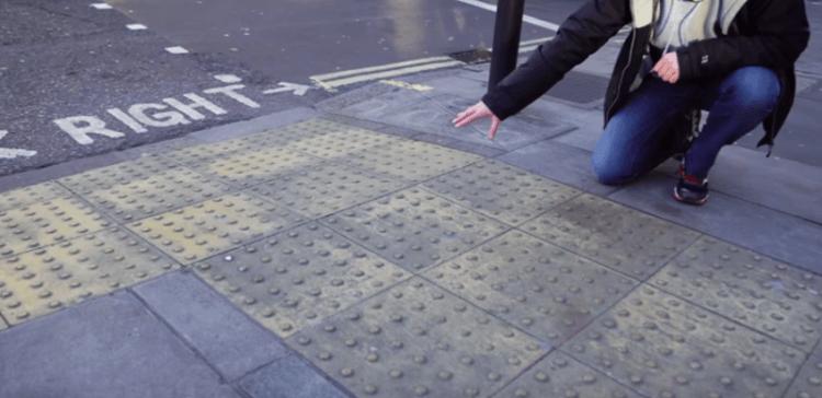 Image of dots on sidewalk.