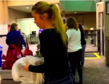 Mackenzie goes through airport security