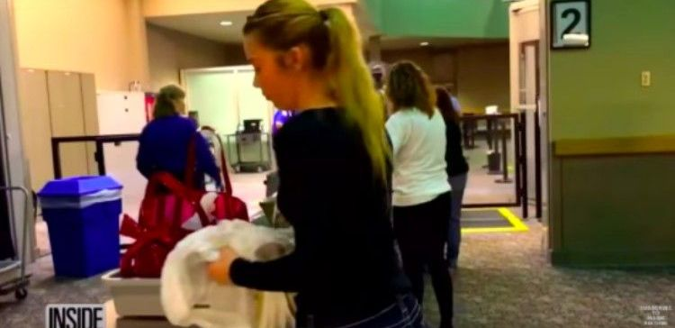 Mackenzie goes through airport security