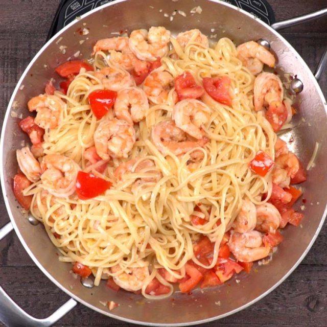 shrimp scampi cooking in pot