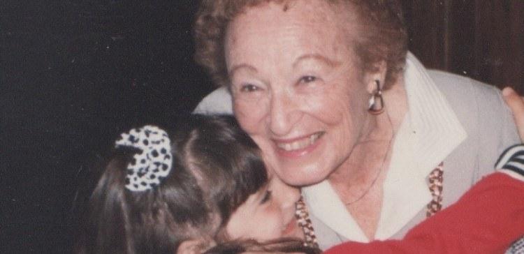 Image of grandmother hugging granddaughter.