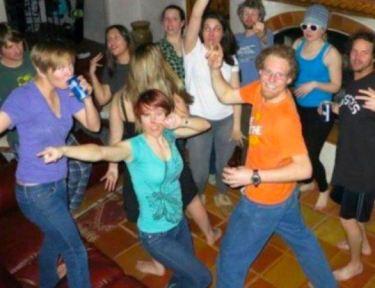 teens dancing in a house