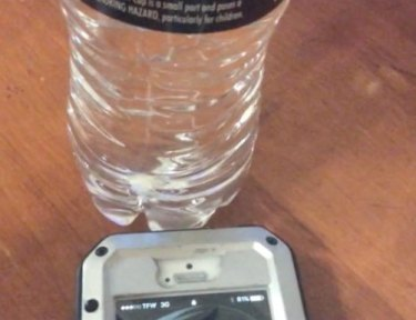 Image of water bottle and phone.