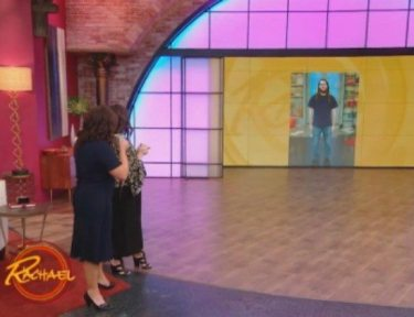 Rachael Ray and stylist stand on stage