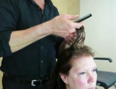Image of Makeover Guy cutting hair.
