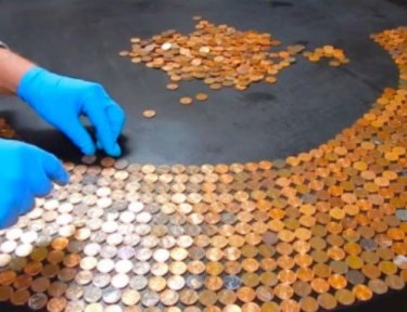 person making penny table