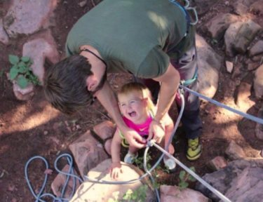Image of toddler with climbing ropes.