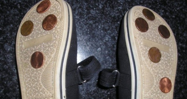 Pennies on the bottom of shoes.