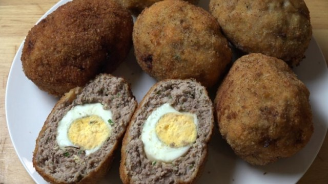 Hard-boiled eggs wrapped in ground meat mixture