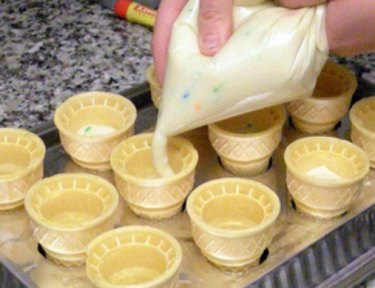 frosting being poured into cones