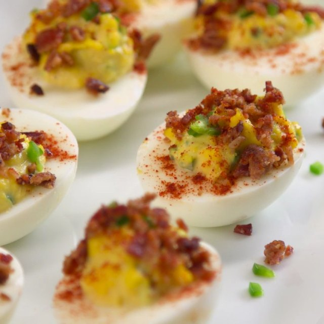 Crispy bacon crumbles and fiery jalapeño peppers make classic deviled eggs even more devilish.