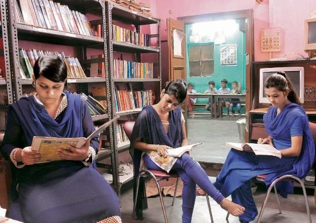 Shabnam (left), Madhu (centre) and Shaista Shamim at Gyan Azhar Library. — Photo: Ashoke Chakrabarty