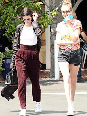 Kendall Jenner and Gigi Hadid share a laugh as they leave Mauro's Cafe at Fred Segal in West Hollywood, Ca Picture by: London Entertainment/Splash Ref: LETG 010616 C Splash News and Pictures Los Angeles: 310-821-2666 New York: 212-619-2666 London: 207-107-2666 photodesk@splashnews.com www.splashnews.com