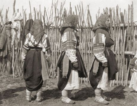 Women in traditional dress and lapti bast shoes