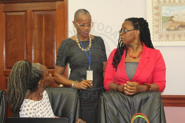 Administrative Officer in the Ministry of Culture Rhonda Greenidge (centre) holds the attention of the Director of the Barbados Cultural Industries Development Authority Andrea King (left) and Chief Cultural Officer at the NCF Andrea Wells (right). (Photo via Barbados Today)