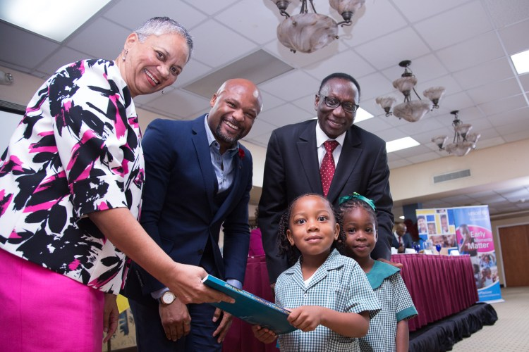 Students of the Beacon Light of the Nazarene School, Antigua and Barbuda hand over newly launched Caribbean Early Childhood Development Good Practice Guide to (from left to right) Ms. Monica La Bennett, Vice-President (Operations), Caribbean Development Bank; Hon. Michael Browne, Minister Education, Antigua and Barbuda; Dr. Aloys Kamuragiye, UNICEF Representative, Office for the Eastern Caribbean. (Photo via CDB)