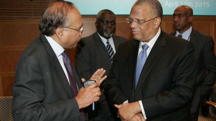 Senior Fellow at the Brookings Institute, Amar Bhattacharya has the rapt attention of Finance and Planning Minister, Dr Peter Phillips at yesterday's first Caribbean Regional Dialogue held with the G20 Working Development Group at the World Bank/ Inter-American Development Bank (IDB spring meeting in Washington DC on Monday, April 13, 2015 at IMF headquarters. At centre is Financial Secretary in the Ministry of Finance and Planning, Mr. Devon Rowe while at right is Mr. Wayne Robinson, a member of the Jamaican delegation. (Photo by Derrick Scott via Jamaica News)