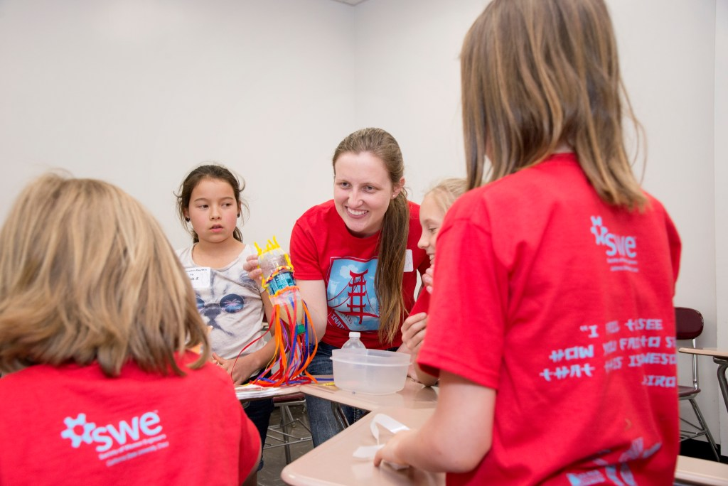 Kylee Davis is shown interacting with young girls at SWE's most recent Imagineer Day. (Photo Courtesy of Jessica Bartlett, Student Photographer)