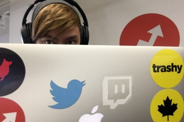 Jeff Barron, behind a laptop covered in social media logo stickers