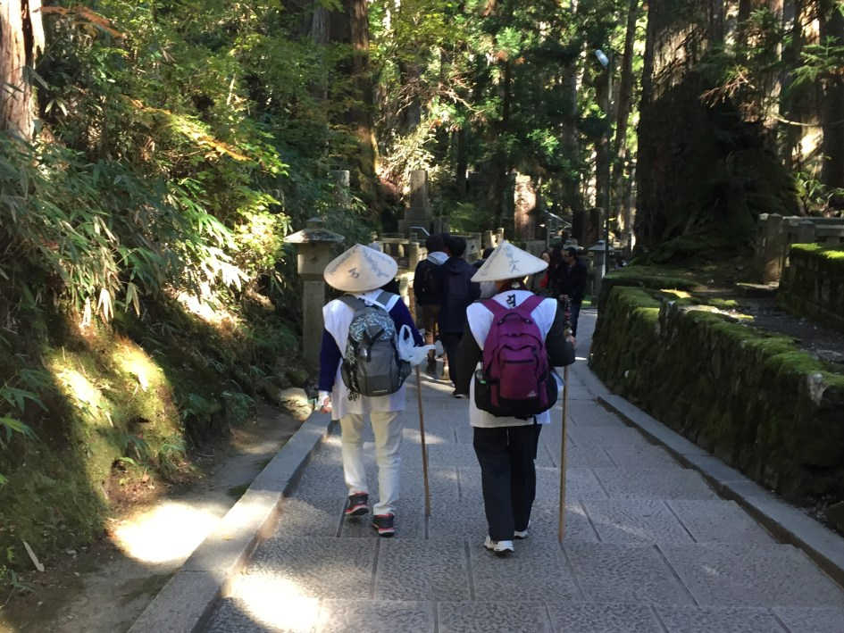 Mt. Koya is part of a World-Heritage honored path followed by Buddhist pilgrims for over a thousand years. There were many pilgrims in Okunoin likely finishing or starting their journeys.