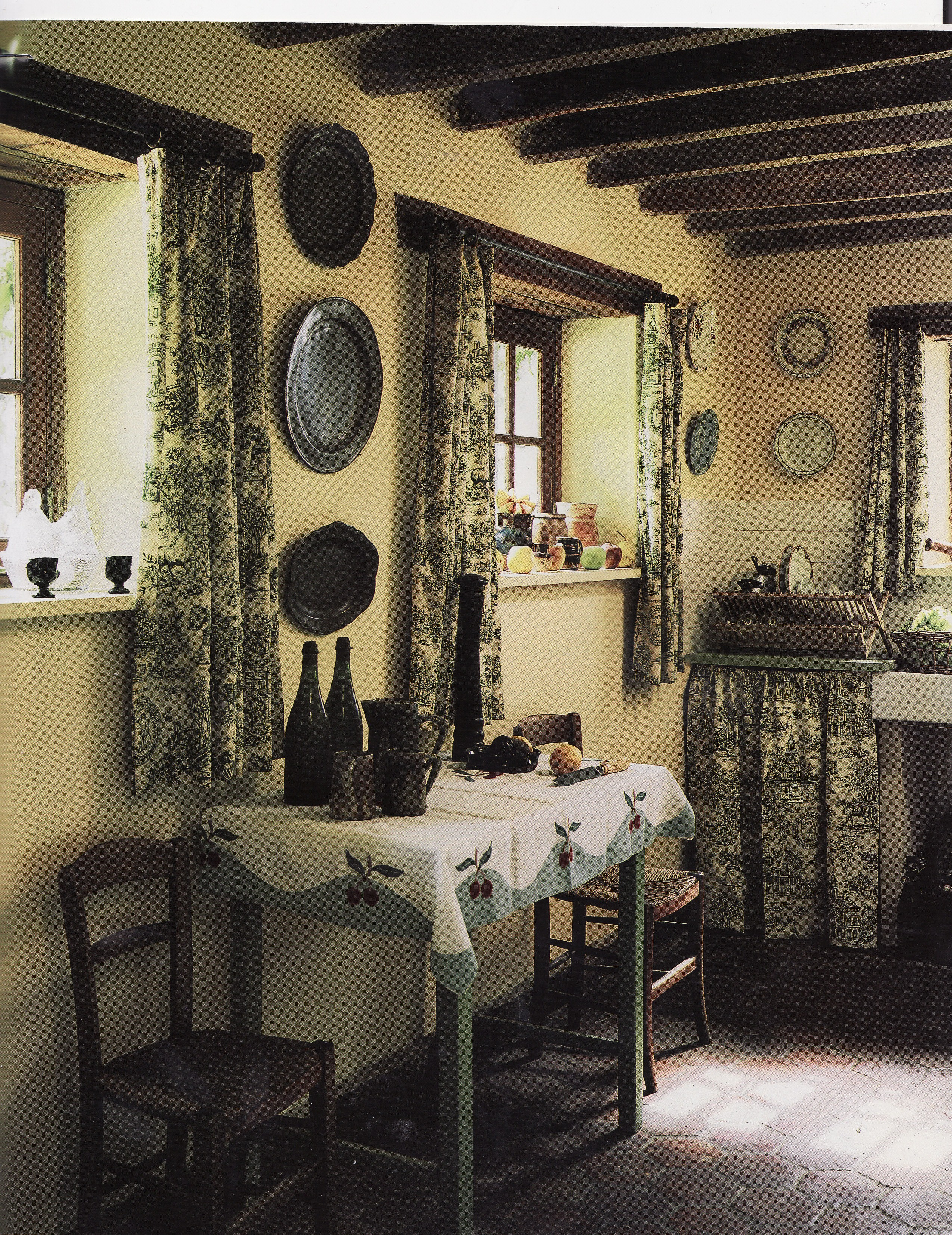 Compared with the manor house above this kitchen with its rustic