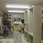 Scott prefinishing cabinets in shop
