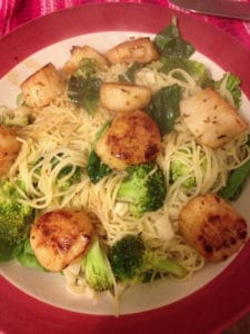Angel hair Pasta  with broccoli, spinach and scallops in garlic and white wine sauce..less than 30 minutes cook time!