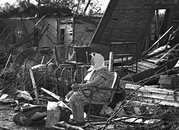 Anna Hunt sits quietly in a lawn chair and waited for someone to pick her up and take her away from her home at 334 S.E. Lime St., which had been reduced to rubble by the tornado.