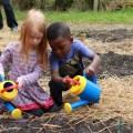 two kids watering the garden