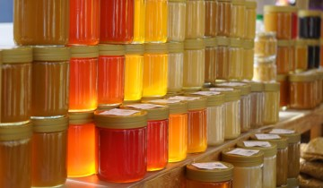 honey jars stacked in the sun